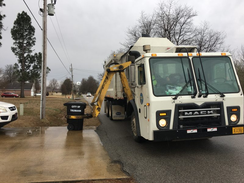Picture of the city garbage truck emptying trash bins